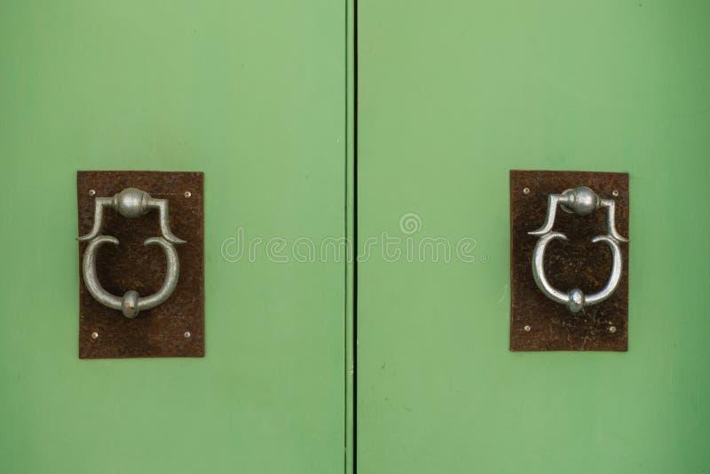 Door knockers. Two pretty door knockers, found on a door in Victoria, capital of the island Gozo, part of Malta stock photos