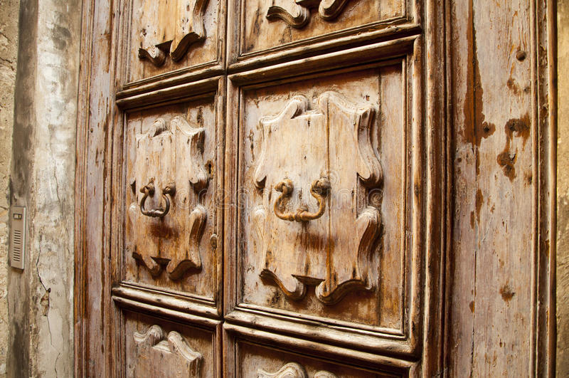 Clappers ancient Italian architecture door early 900 & Door knocks stock photo. Image of rusty lion knock - 35916638