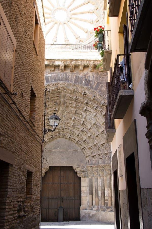 The Door of the Last Judgement, Tudela, Spain. Puerta del Juicio, Cathedral of The Door of the Last Judgement, Tudela, Spain. A pug looks on from a balcony royalty free stock images