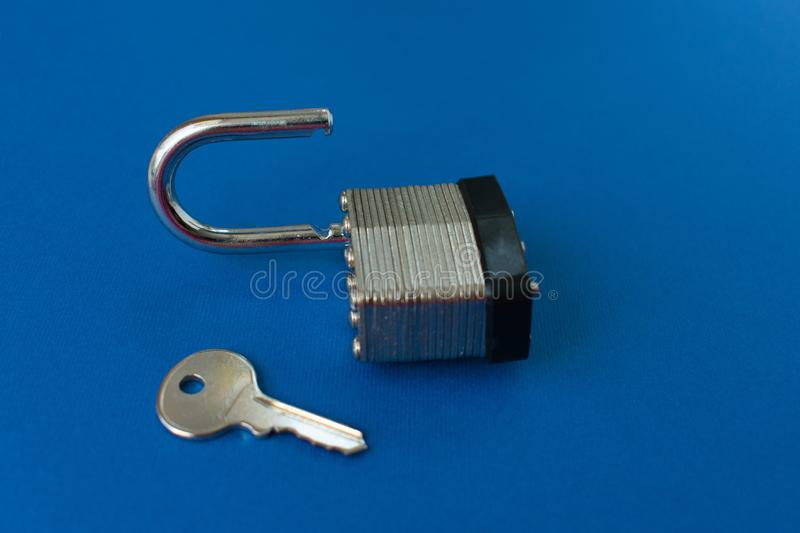 Door lock and key. Lock and key on and blue background royalty free stock photos