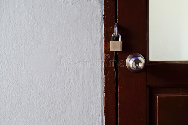 Door locked with padlock save house stock images