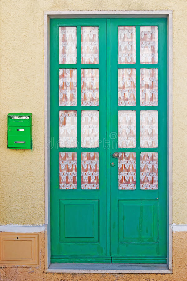 Door and mailbox. Green door and mailbox in a rustic wall stock photo
