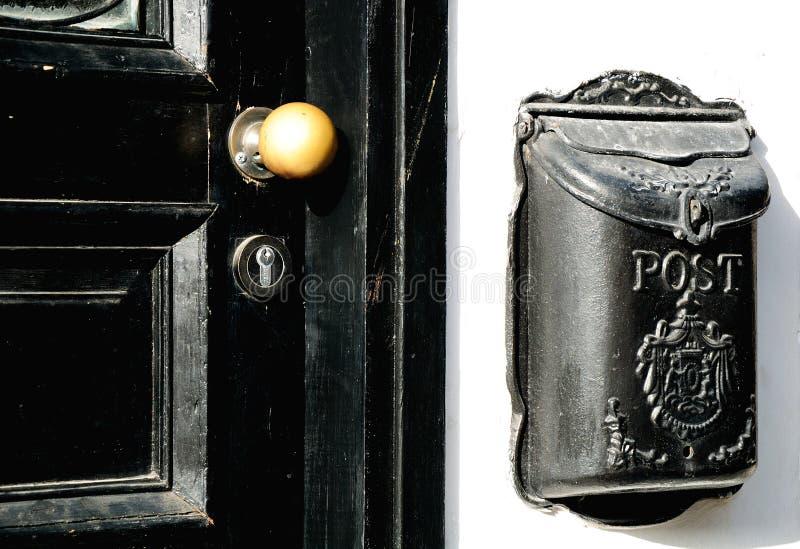 Door and mailbox. Door of old house with the big metal mailbox. Tel Aviv stock photo