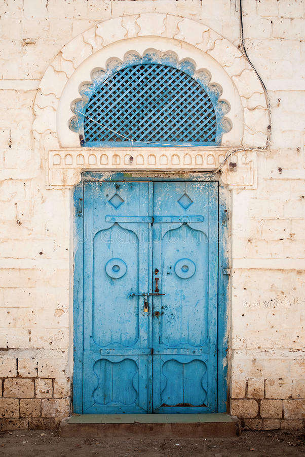 Door in massawa eritrea with ottoman influenced ar. Door in central massawa eritrea with ottoman influenced architecture stock image