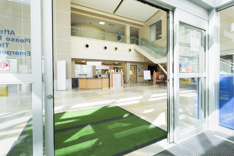 Door Mats At The Entrance Of Hospital. With reception area in background royalty free stock photos