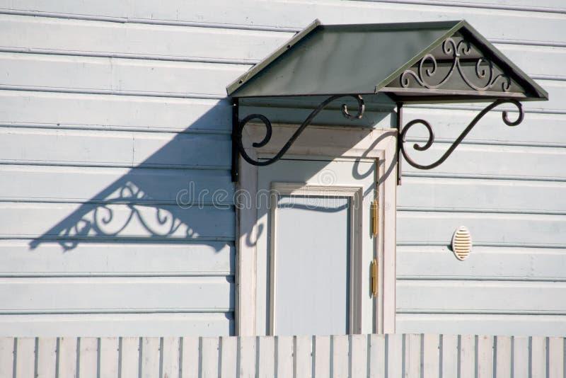 Door with Metal Awning stock photo