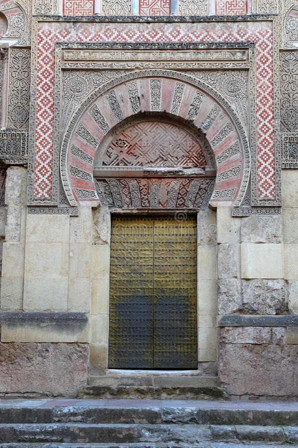 Door of the mosque of Cordova. Court of the orange trees, Mosque of Cordova is part of the Cathedral Mosque of Cordoba, and is undoubtedly the largest and stock images