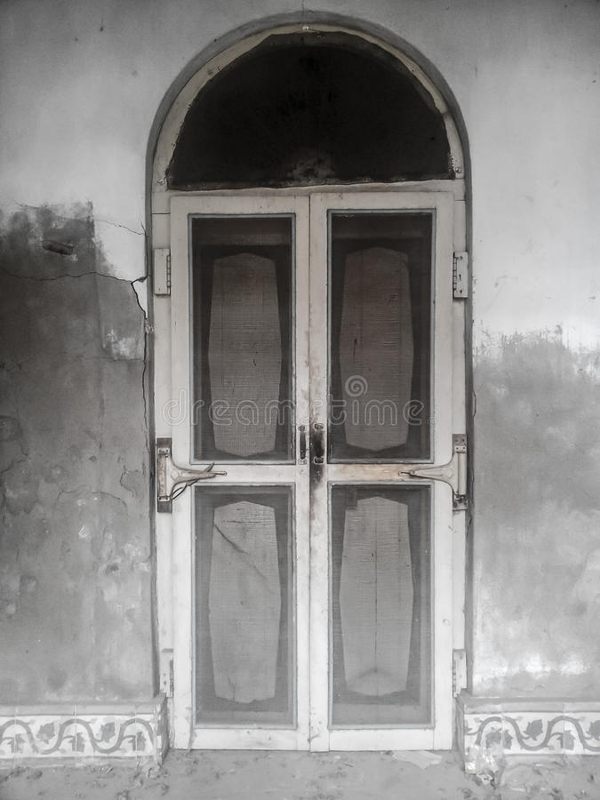 Door of Old House. This is a Door of old house which is build in indian style house at shikarpur, sindh Pakistan stock image