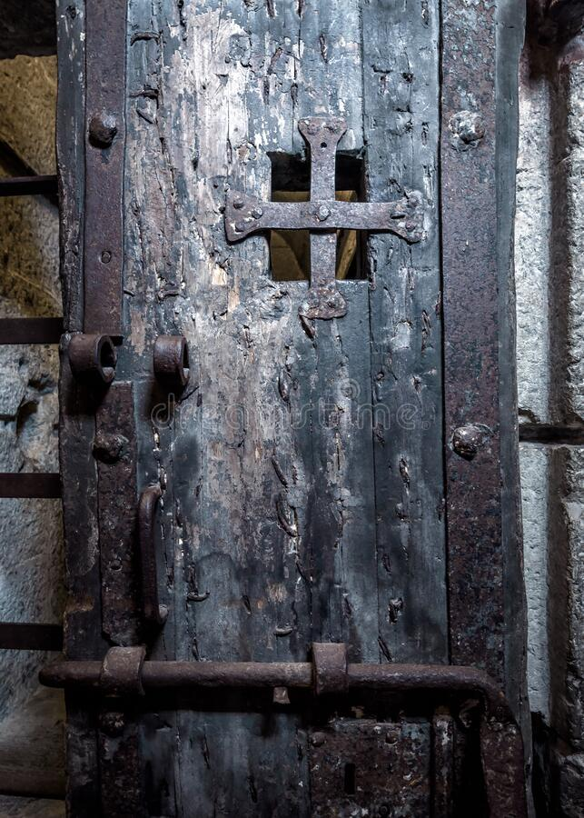 Door in old prison closeup. Inside dark medieval prison stock images