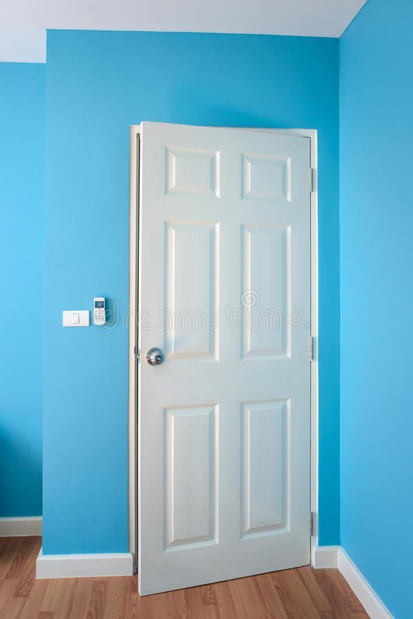 The Door is open in blue room. Empty room stock photo