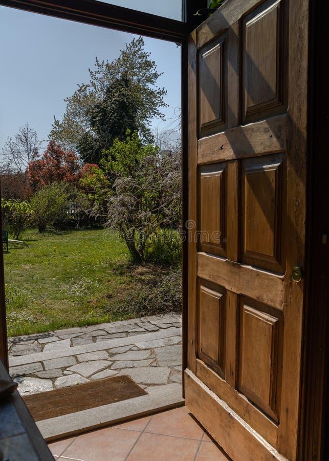 Door open on spring. Garden stock photo