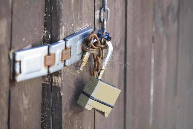 Door padlock and chain high security protection at house home domestic burglary robbers stock photography