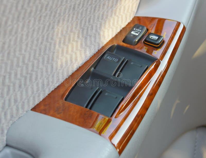 Door panel controls. Door and window controls on interior car door panel stock photography