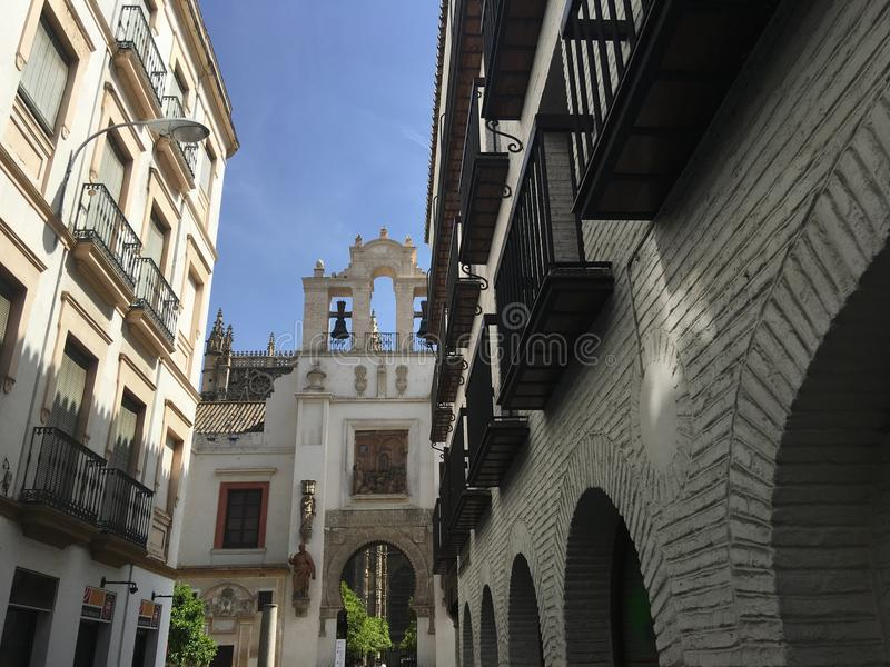Door of Pardon and Patio de los Naranjos. From the Calle Hernando Colon street in the old town of Seville Spain royalty free stock photo