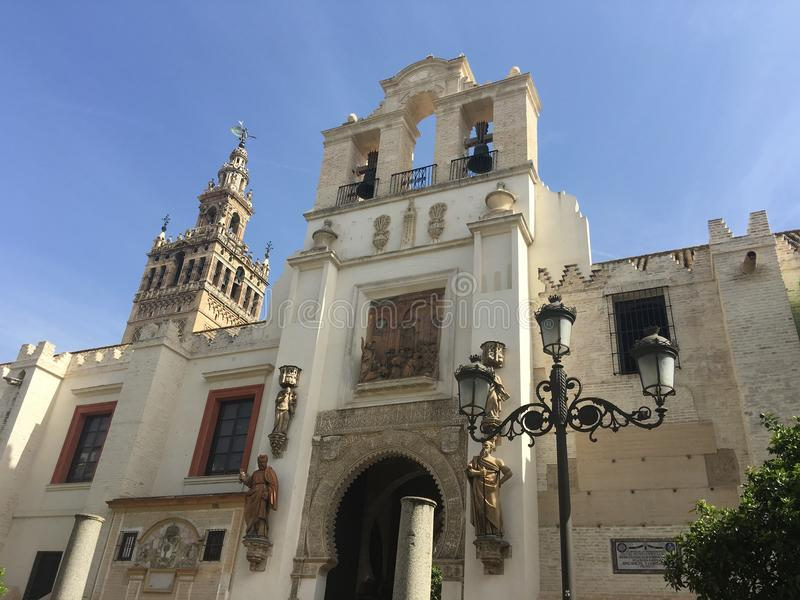 Door of Pardon and Patio de los Naranjos. With the La Giralda (Bell tower) from the Seville cathedral in Spain stock photography