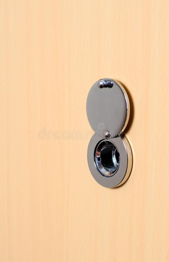 Door peephole on the door. Space for text. Vertical photo. Door peephole on the door. Close up. Space for text. Vertical photo royalty free stock photography