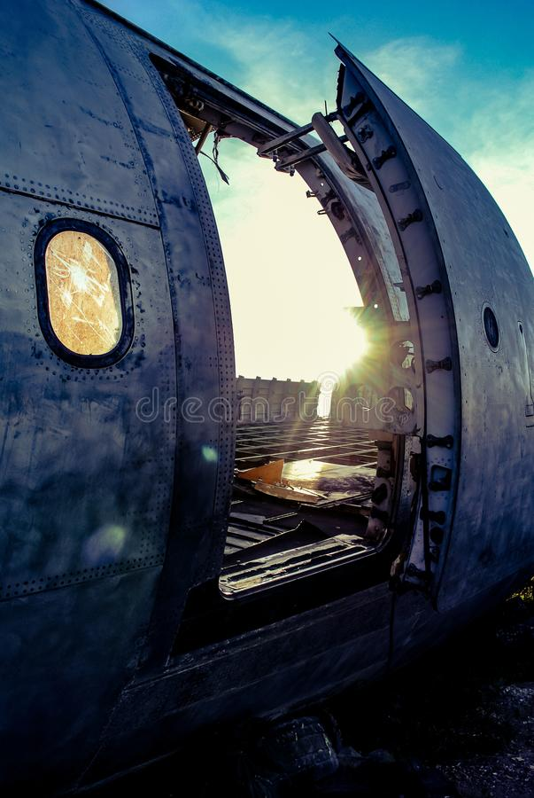 Door of plane wreck at abandon field royalty free stock images