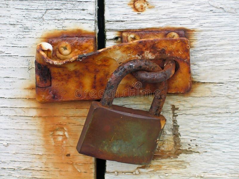 Door with rusty lock. Door locked with an old rusty lock royalty free stock photos