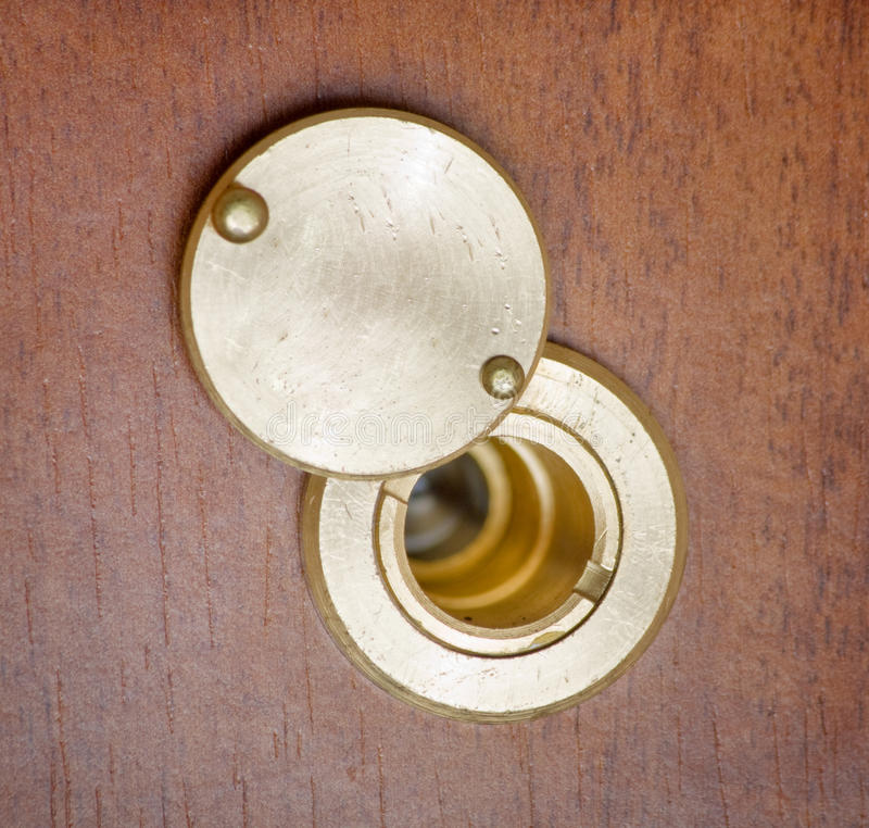 Door spy hole or peephole. Spy hole or peephole view at door royalty free stock photos