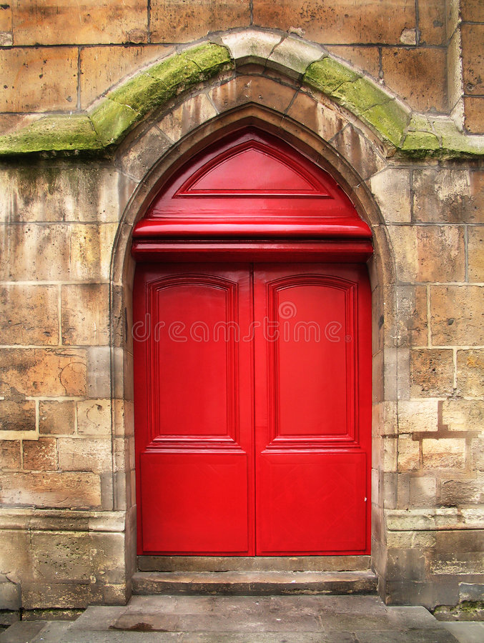 Door of the stone cathedral stock photos