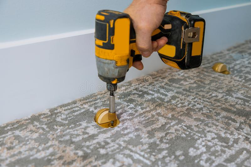 Door stopper installed with carpet floor using screwdriver. Door stopper installed with carpet floor in using screwdriver, installation, stainless, design, home stock photos