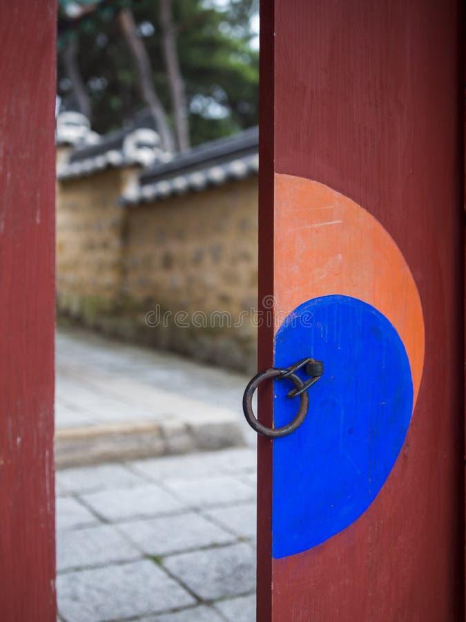 Door in Sungsinjeon shrine in Gyeongju, South Kore. Architectonic detail of Sungsinjeon shrine - taijitu symbol (yin and yang symbol) on the door royalty free stock images