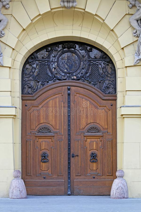 Door Szeged City Hall. Wooden Arch Door Entrance in Szeged City Hall royalty free stock images