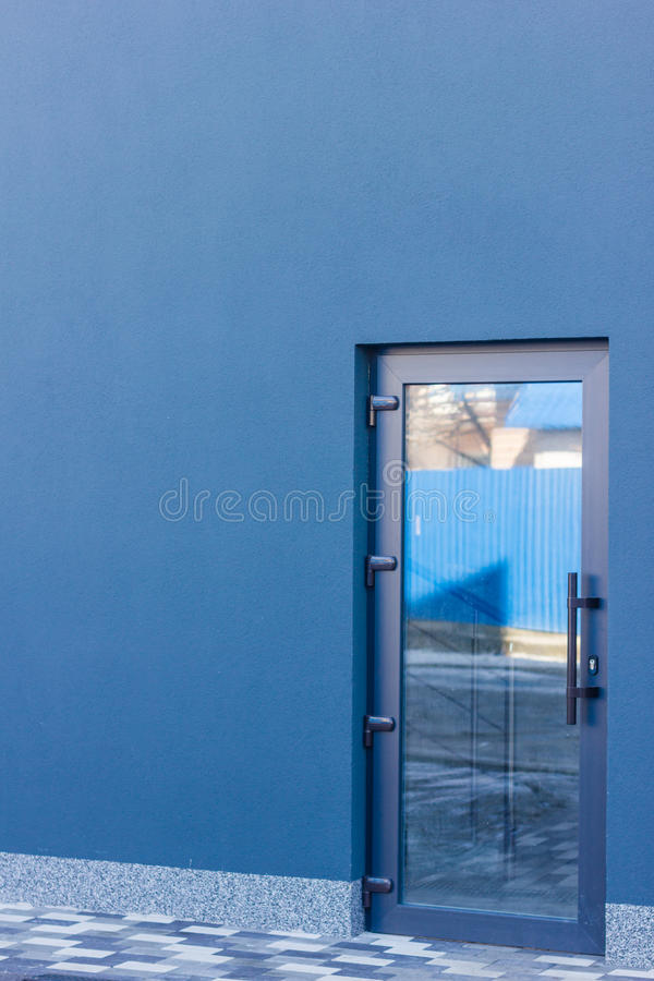 The Door Tinted Glass With A Grey Frame In The Office Building