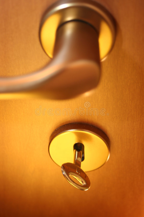Door to be open. A close wood door (like an office or room door) with key, ready to be open. Focus on key stock photos