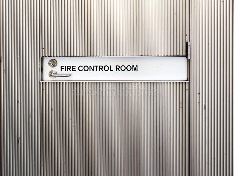 Door to Fire Control Room. A locked external door sign `Fire Control Room`, mandatory signage, on a ribbed aluminium door royalty free stock images