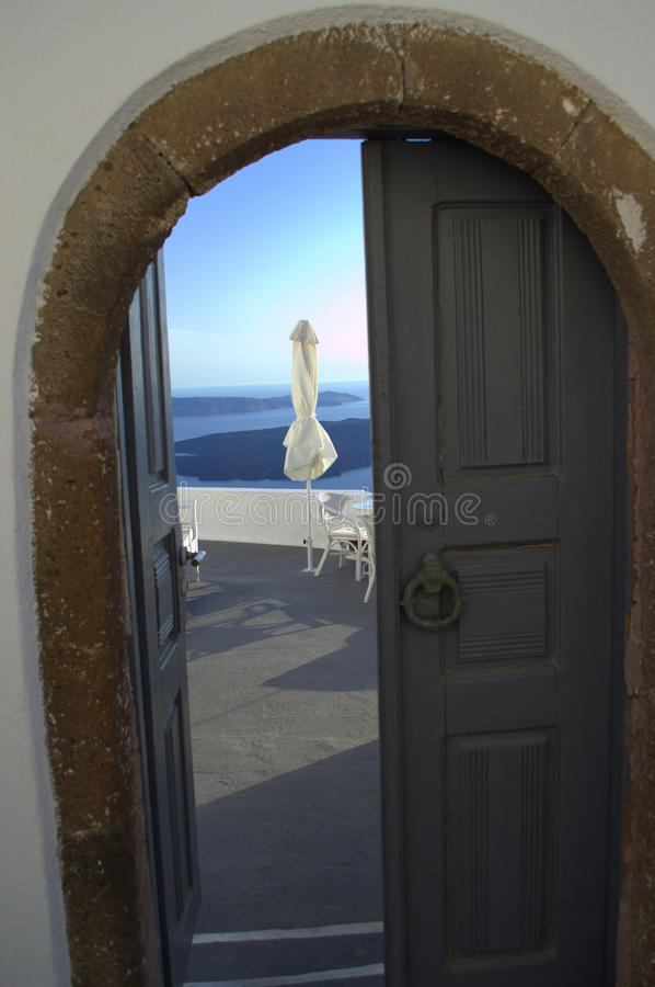 Door to Heaven. Picture taken at Firostefani,Santorini,Greece during my unforgettable vacation at this heavenly place. Opposite is seen the south part of the royalty free stock photos