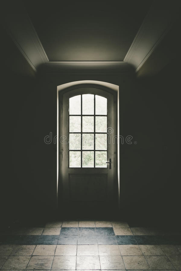 The door to light. An entrance door by the light shines stock images