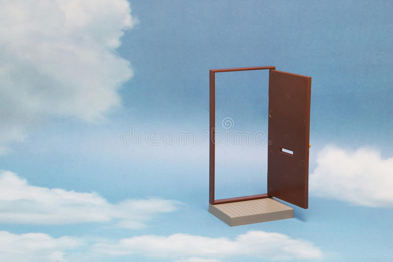 Door to new world. Open door on blue sunny sky with fluffy clouds. Concepts like new life, success, future perspective, hope, religion royalty free stock image