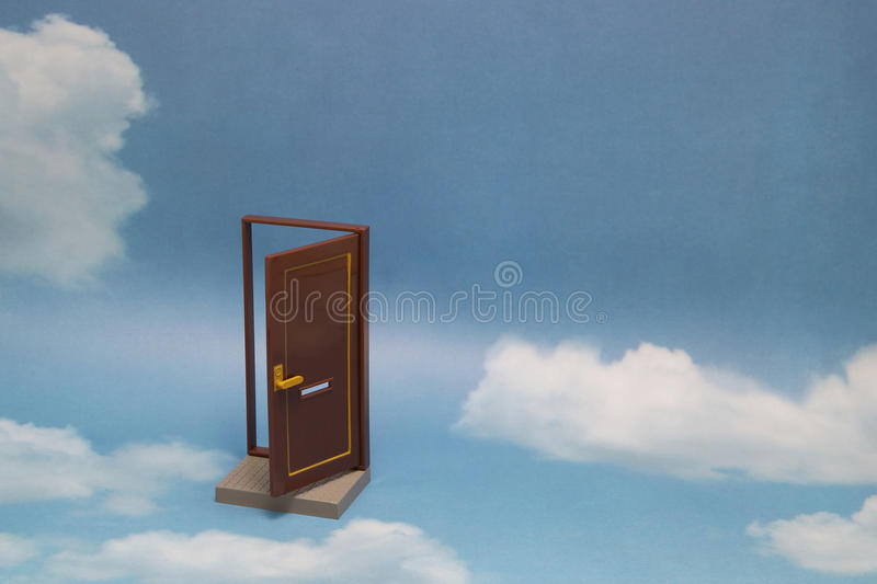 Door to new world. Open door on blue sunny sky with fluffy clouds. Concepts like new life, success, future perspective, hope, religion royalty free stock photography