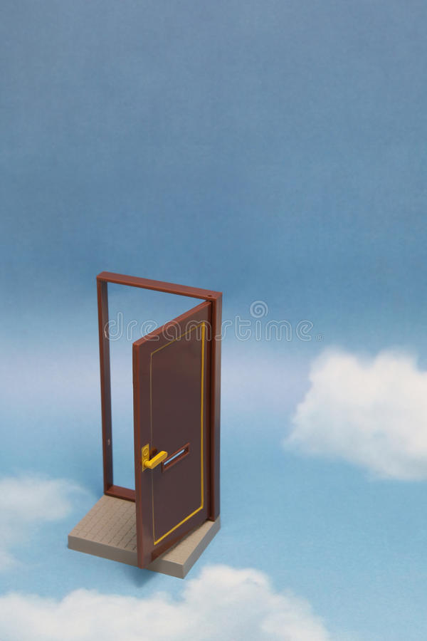 Door to new world. Open door on blue sunny sky with fluffy clouds. Concepts like new life, success, future perspective, hope, religion stock images
