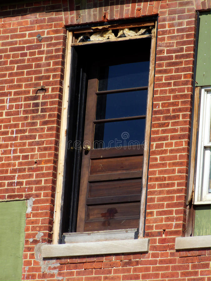 Door to Nowhere. Door in condemned building opening dangerously to missing staircase royalty free stock photography