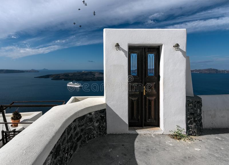 A door to nowhere. Santorini. Greece. The white city of Santorini. View of the caldera and the volcano. The beauty of the white island royalty free stock photography