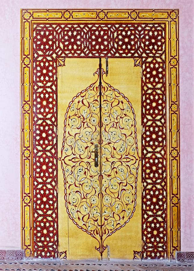 The door to the palace in the city of Fez in Morocco, painted with intricate, beautiful, multi-colored patterns in oriental style stock image