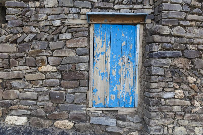 A door to the utility room in a house in the village of Khinalig. Travel royalty free stock image