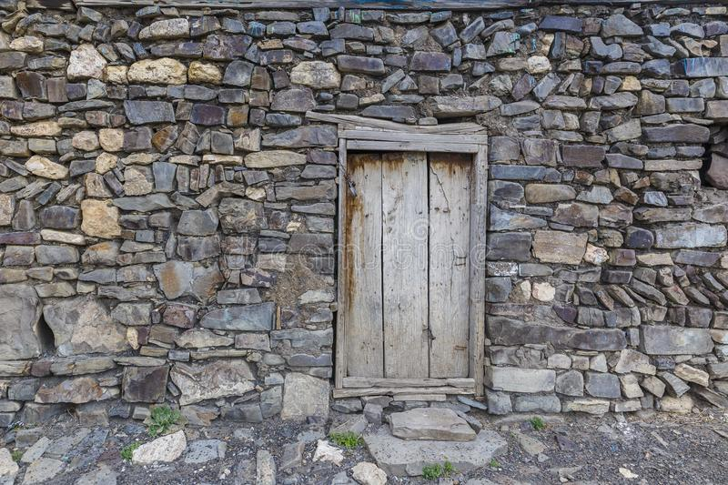 A door to the utility room in a house in the village of Khinalig. Travel royalty free stock photo