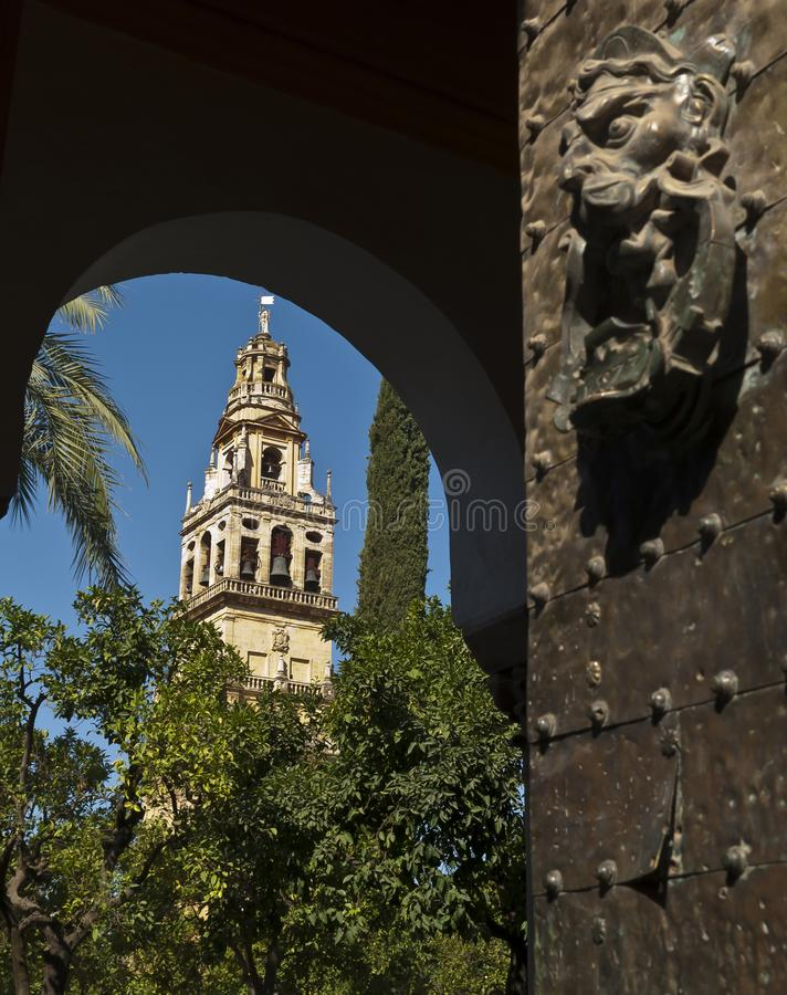 Door and tower of the mosque of Cordoba. Door and tower of the mosque of Córdoba, entrance to the patio of los naranjos from the east entrance stock photography
