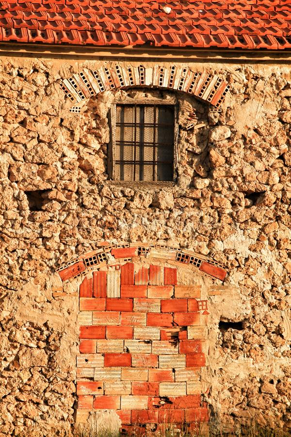 Door and window boarded up with bricks royalty free stock images
