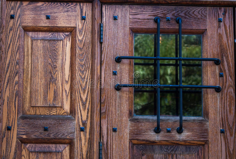 Door and window with heavy grate stock photography