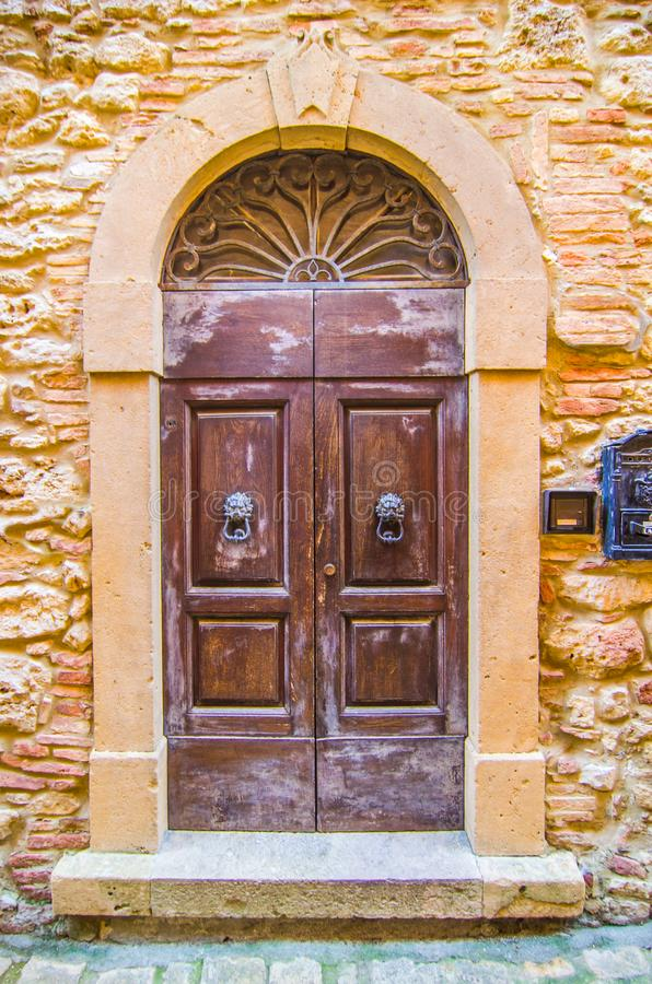 Door with wooden arch craft of ancient building royalty free stock photography
