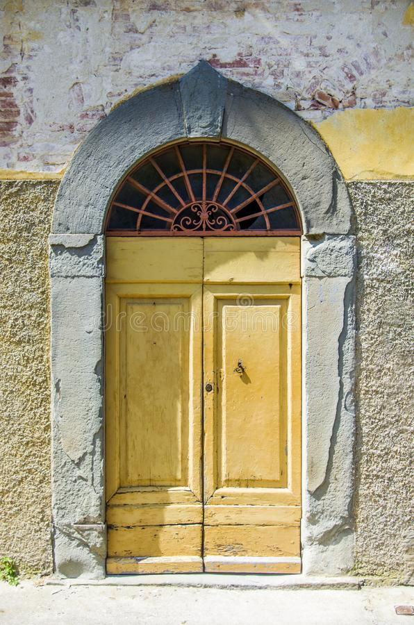 Door with wooden arch craft of ancient building royalty free stock image