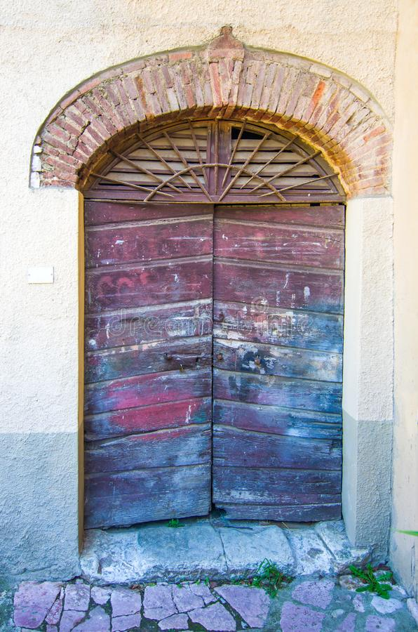 Door with wooden arch craft of ancient building stock photos