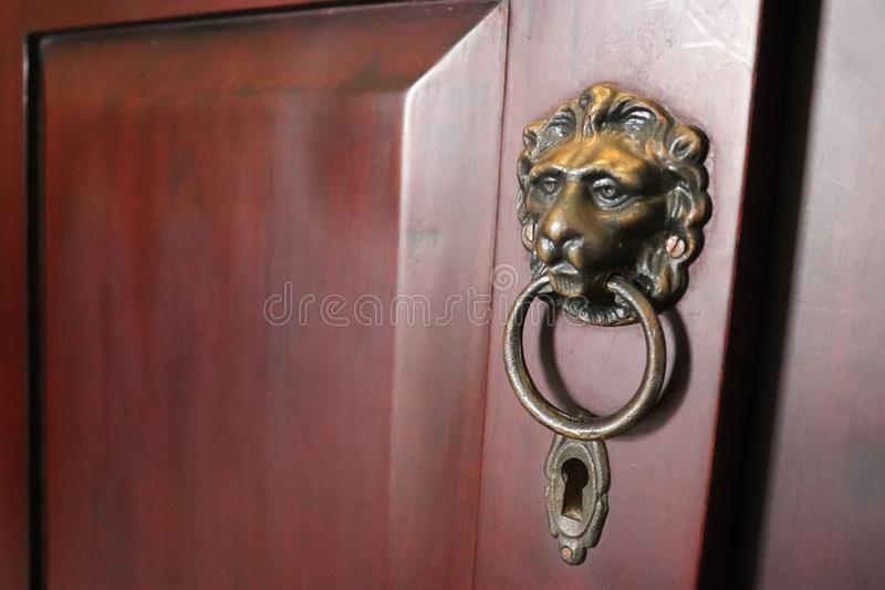 Doorknob golden lion head and keyhole stock photos