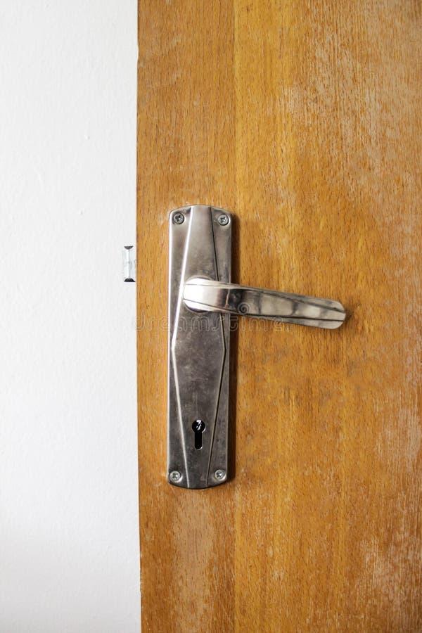 Doorknob. Old Doorknob with keyhole on wooden door royalty free stock image