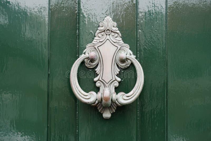 Download Doorknocker In Silver On Green Painted Wooden Door Stock Photo - Image: 8431222