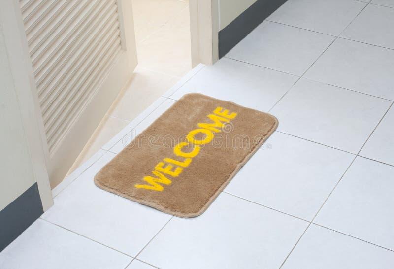 Doormat in front of the rest room stock image
